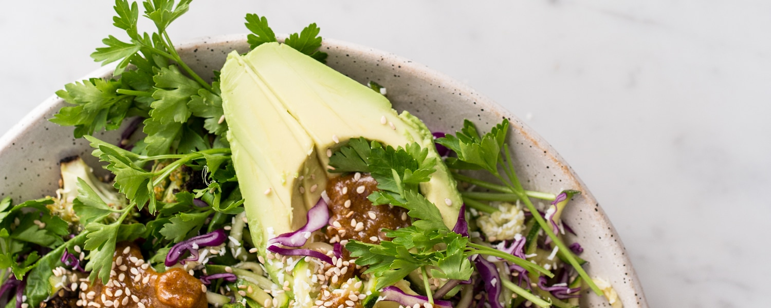 green salad with coconut and turmeric dressing